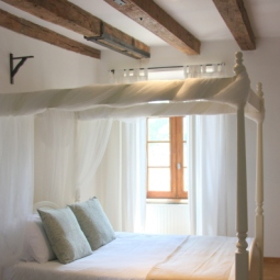 Four poster lavender bedroom